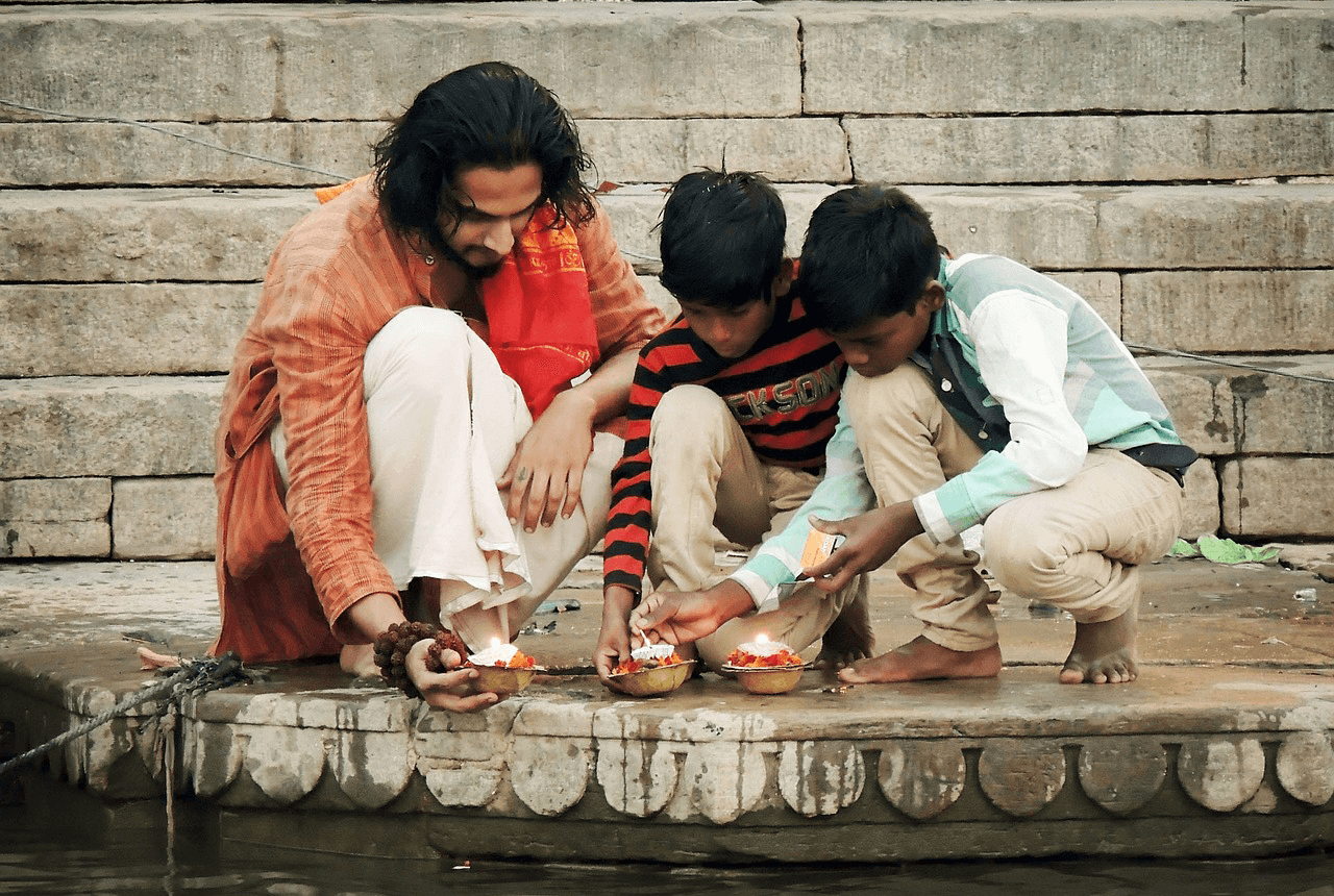 Dad with sons near the river in India