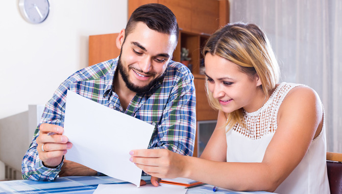 Couple filling forms for bank