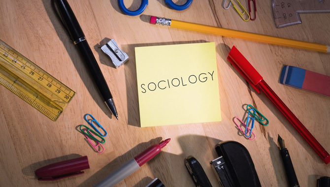 Sociology against students table with school supplies